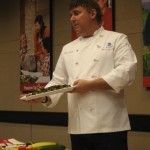 Chef Mark shows off a plate of roasted Brussels sprouts